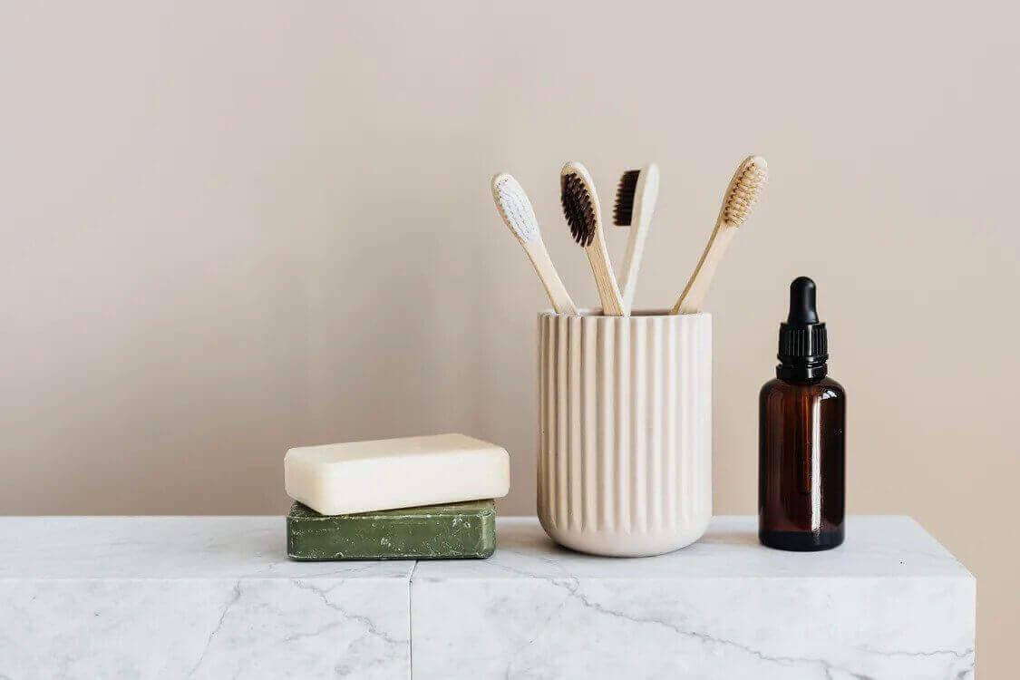 soap bar, toothbrushes, and a serum