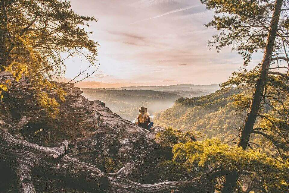 Girl overlooking the view from a mountain