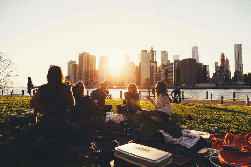 People sitting in a park in New York