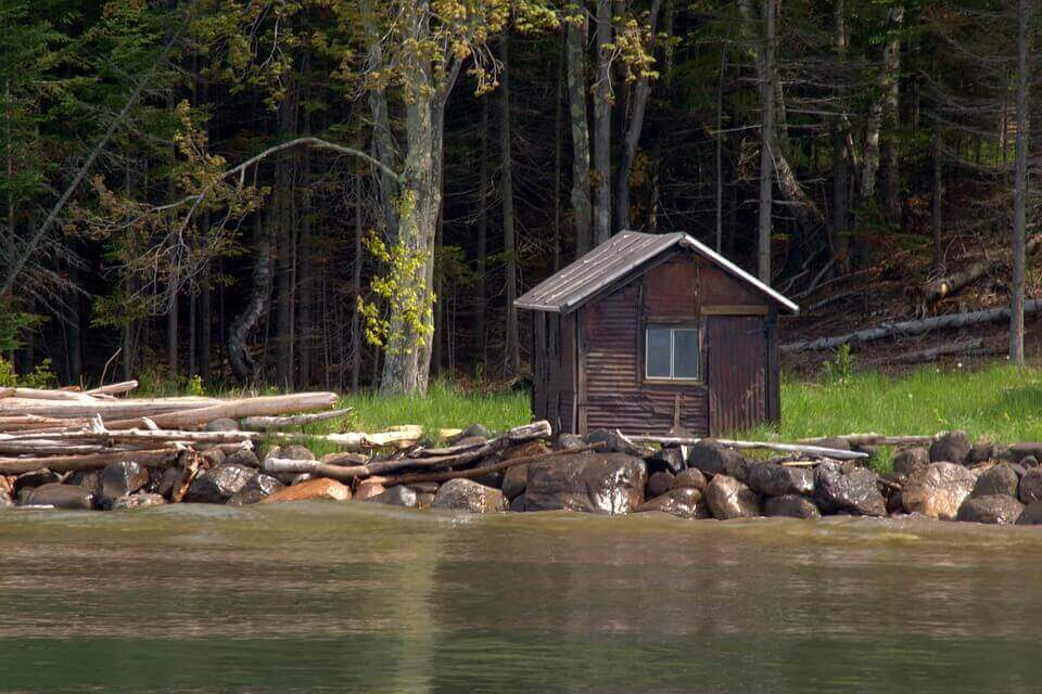 A wooden cabin by the lake