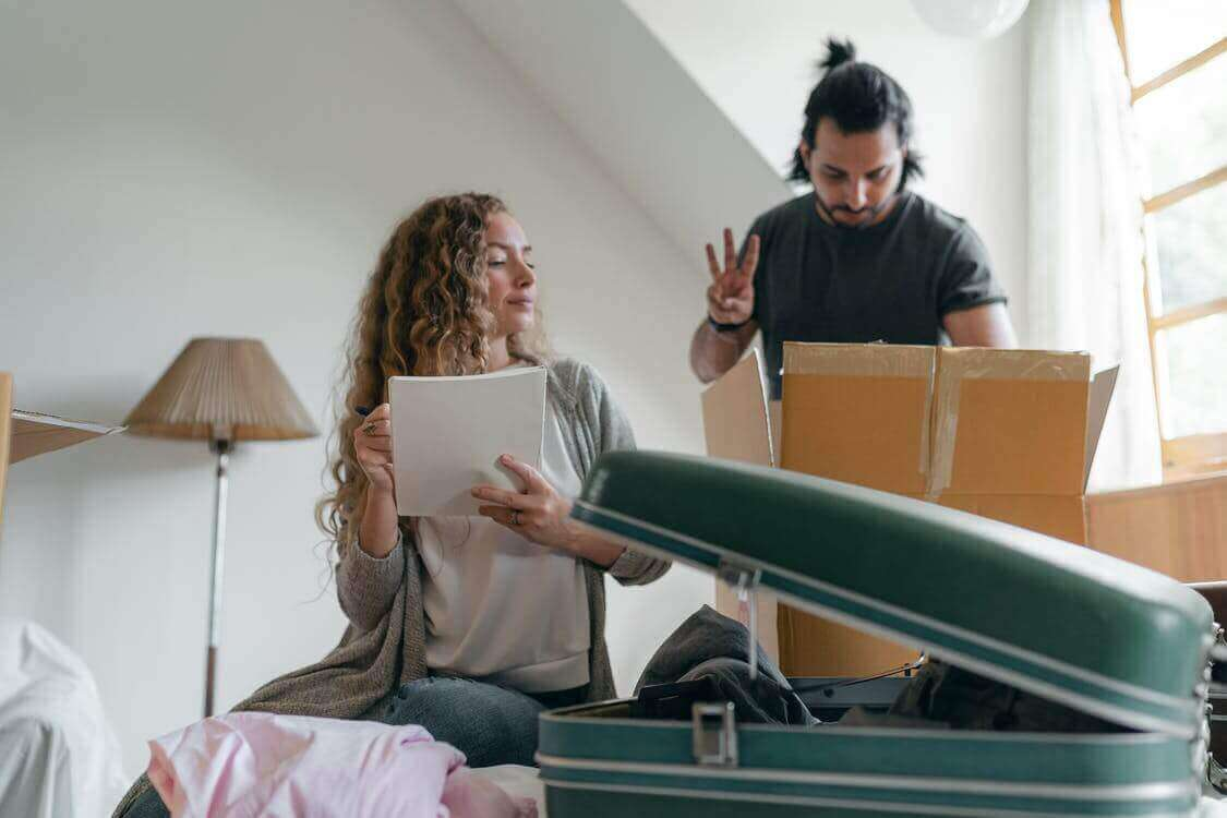 Couple is packing a suitcase