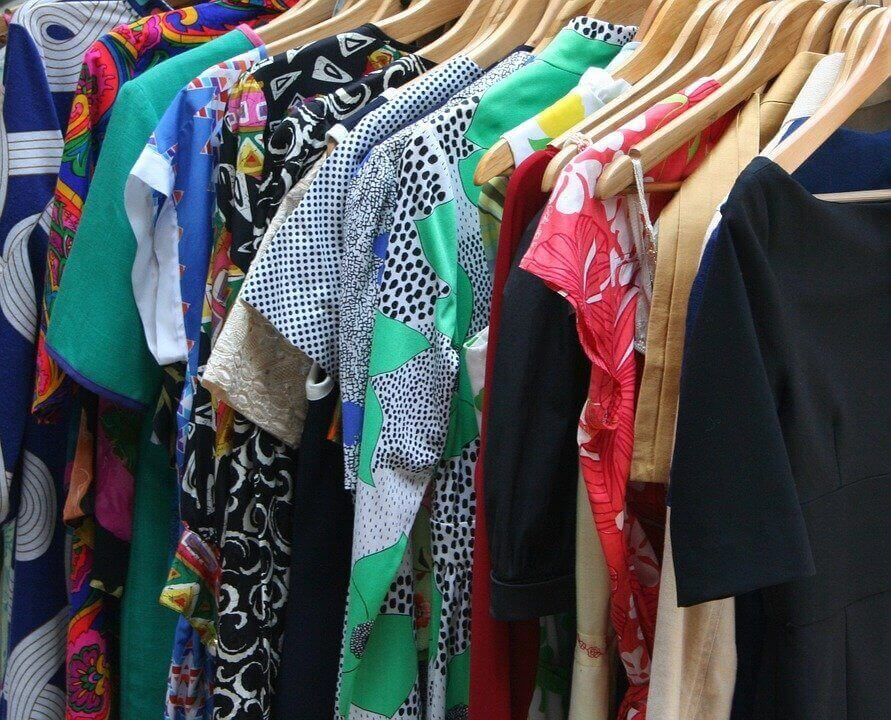 an image of dresses on hangers