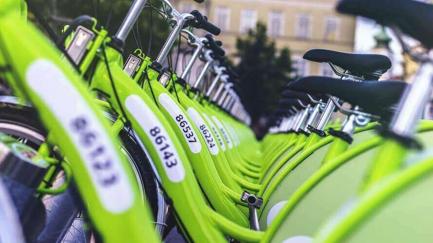 Green bicycles in a line