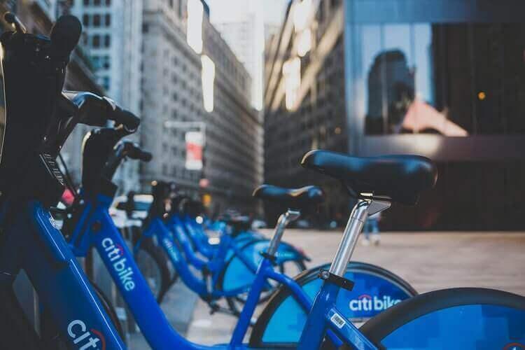 Citi Bikes parked on a sidewalk