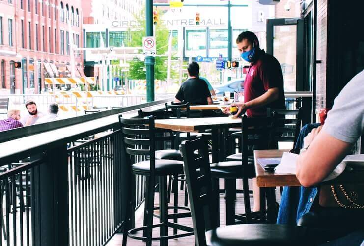 Waiter Wearing a Mask on a Patio