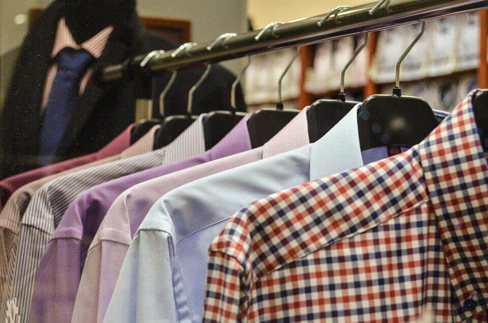 an image of men's shirts on hangers