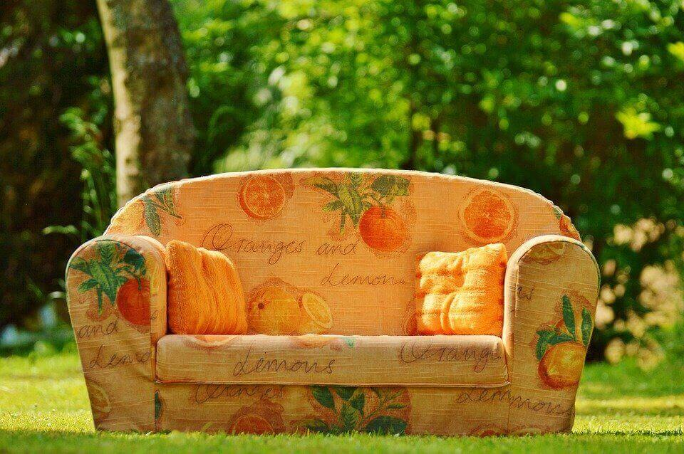 an image of an orange couch on the grass