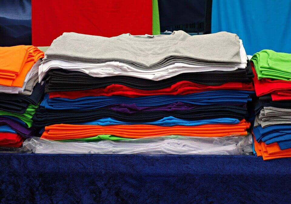 an image of folded colorful shirts