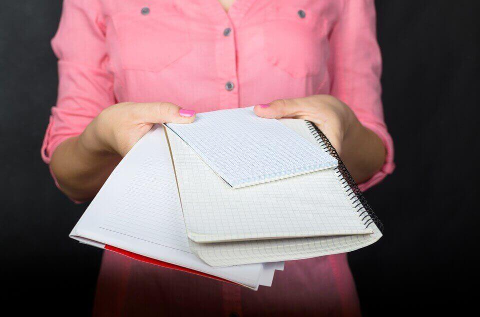Girl holding notebooks