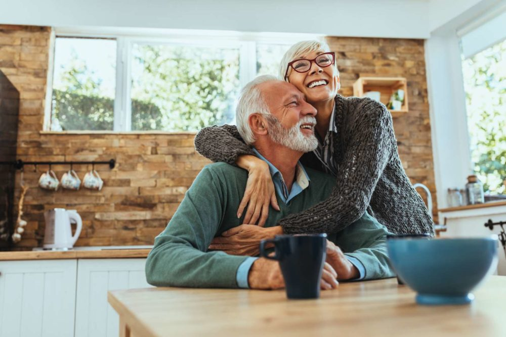 An older couple looking happy