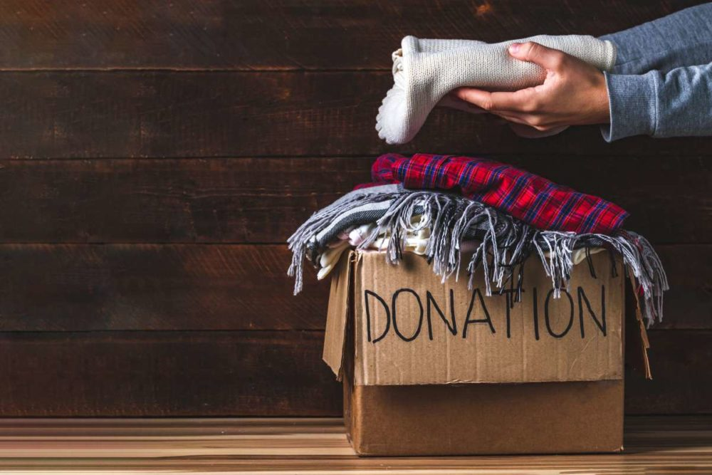 Person deciding what to donate and what to relocate with the help of New York movers
